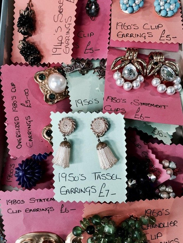 Vintage earrings for sale at a flea fair in Malvern, Worcestershire, England.