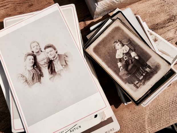 Piles of old pictures at a flea fair in Malvern, Worcestershire, England.