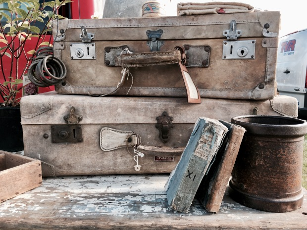 Old suitcases and books for sale at a flea fair in Malvern, Worcestershire, England.