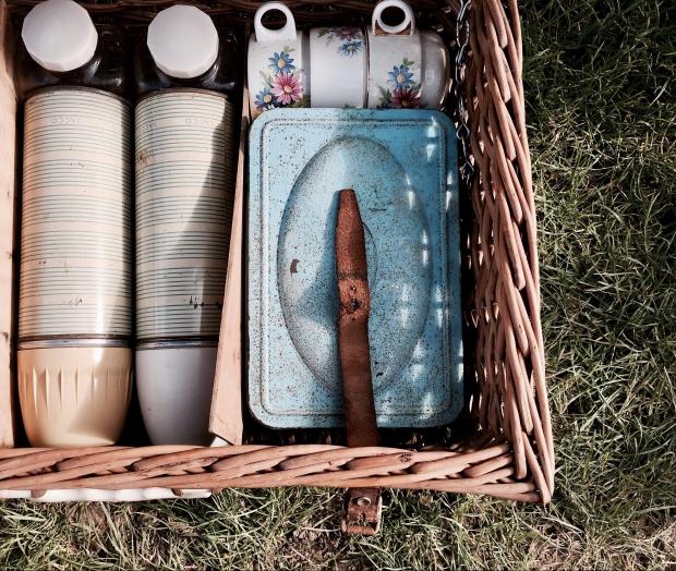 Vintage picnic basket for sale at a flea fair in Malvern, Worcestershire, England.