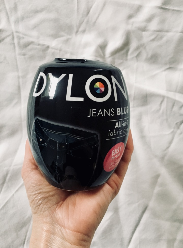 Hand holding pod of Dylon fabric dye.
