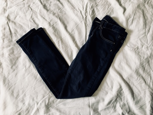 Flat lay of dark indigo pair of jeans.