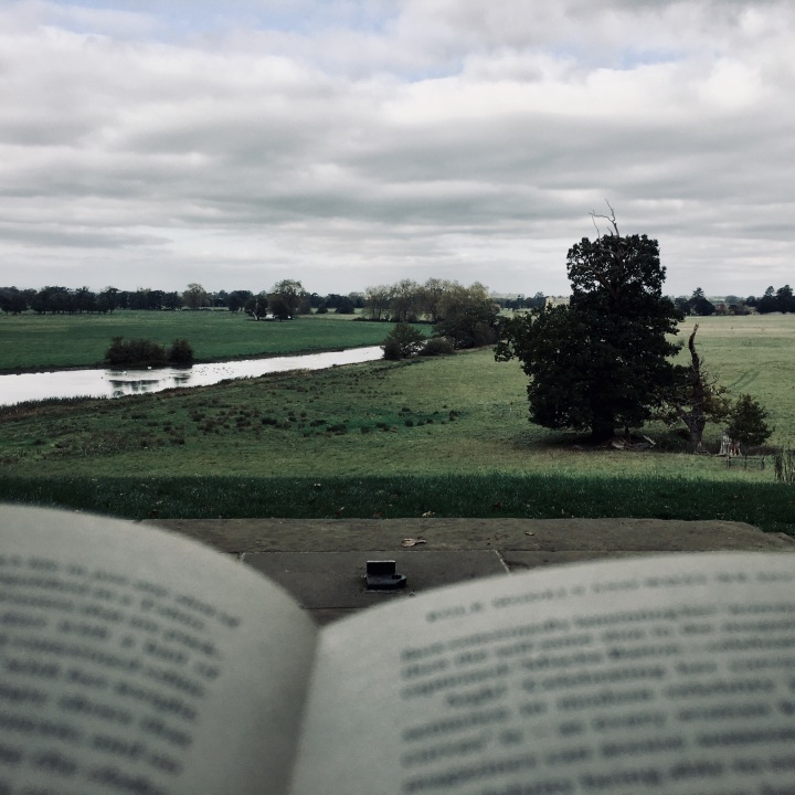 Peering over the top of a book onto the Croome Park estate in Worcestershire, England.
