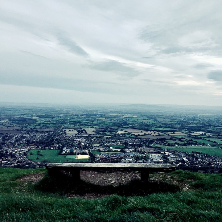 Wooden bench on Malvern Hills overlooking the town of Great Malvern.