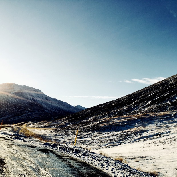 Snowy mountains near Bakki, Iceland.