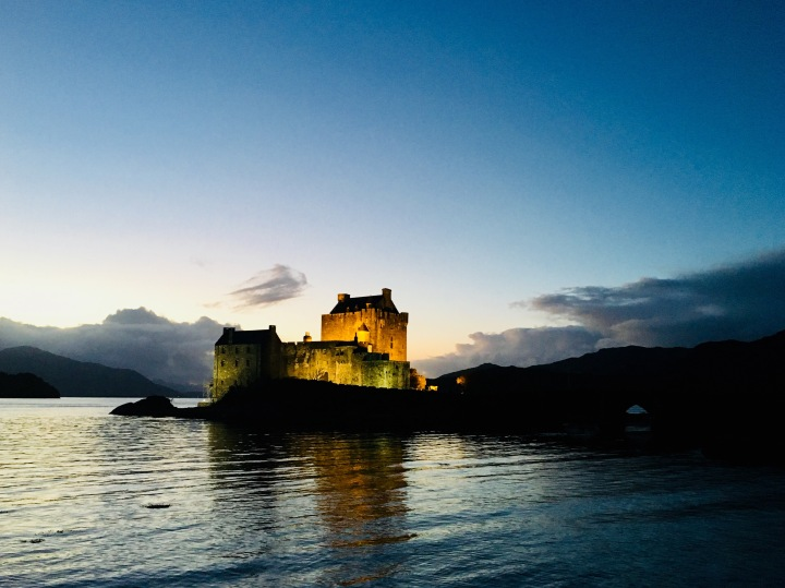 Eilean Donan castle in Scotland at dusk.