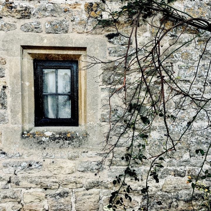 Window of cottage in Arlington Row, Bibury, Gloucestershire.