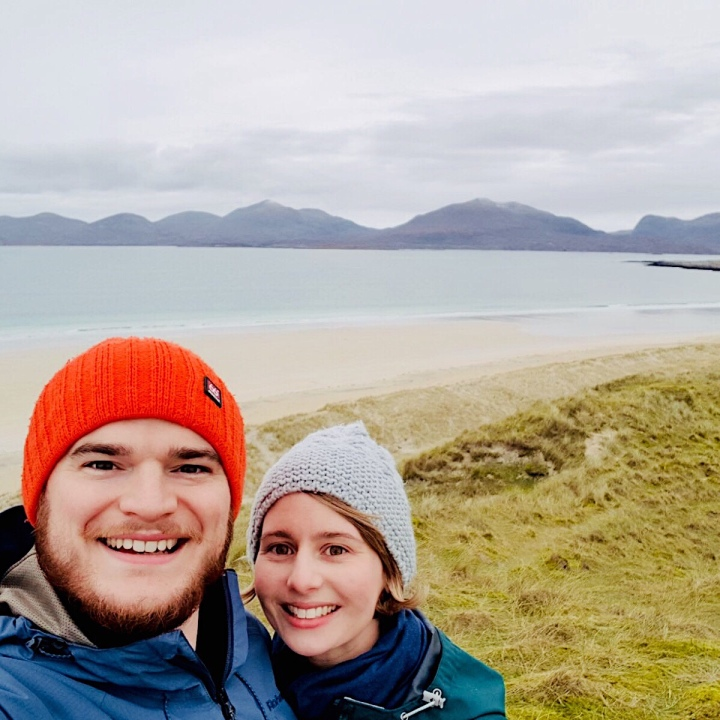 Couple posing for picture on Luskentyre Beach, Harris, Scotland.