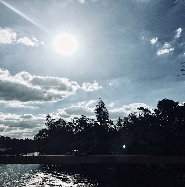 Bright sun shining down on Murrumbidgee River at Wagga Wagga, NSW, Australia.