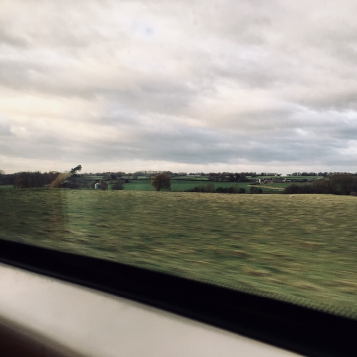 Looking out of train travelling through England.