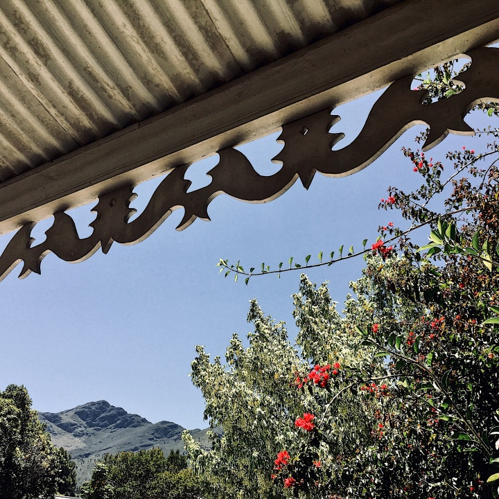 Looking out from a verandah towards the Franschhoek Valley, Western Cape, South Africa.