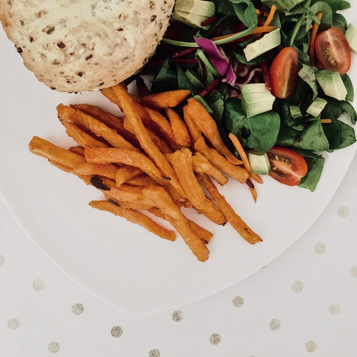 Home made burgers with sweet potato fries and a side salad.