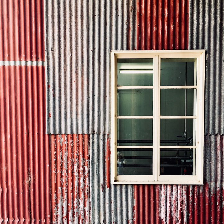 Window on corrugated iron wall in regional Australia.