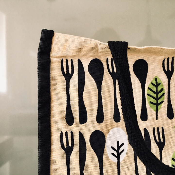 A reusable jute shopping bag.