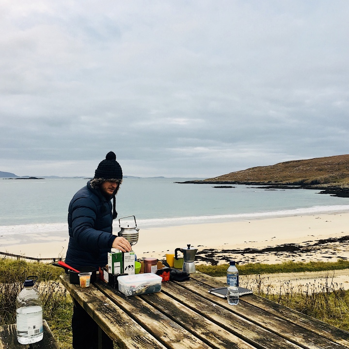Man preparing meal at the Huisinis Gateway, Isle of Skye, Scotland.