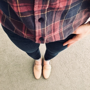 Blue jeans, navy and burgundy check shirt and nude loafers.