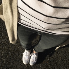 Black jeans, black and white stripe t-shirt, grey cardigan and white sneakers.