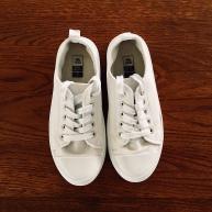 White sneakers.