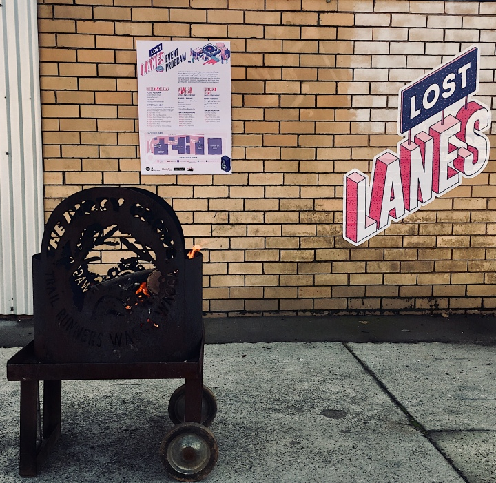 Fire bucket and official signage for the Lost Lanes festival in Wagga Wagga, New South Wales, Australia.