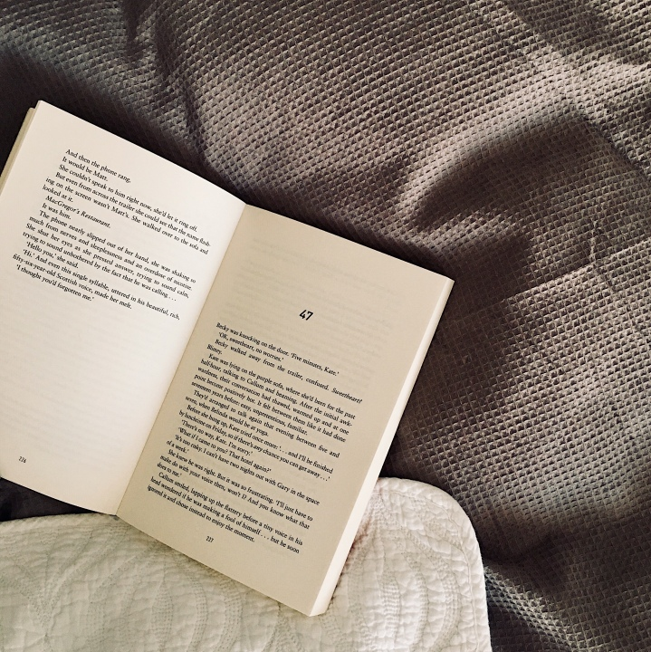 Open book on bed.