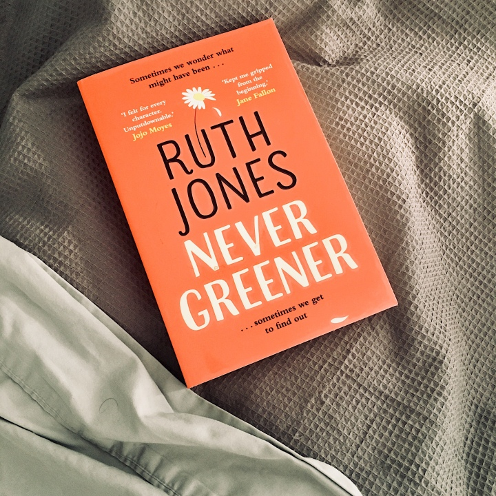 Ruth Jones' 'Never Greener' sitting on a bed.