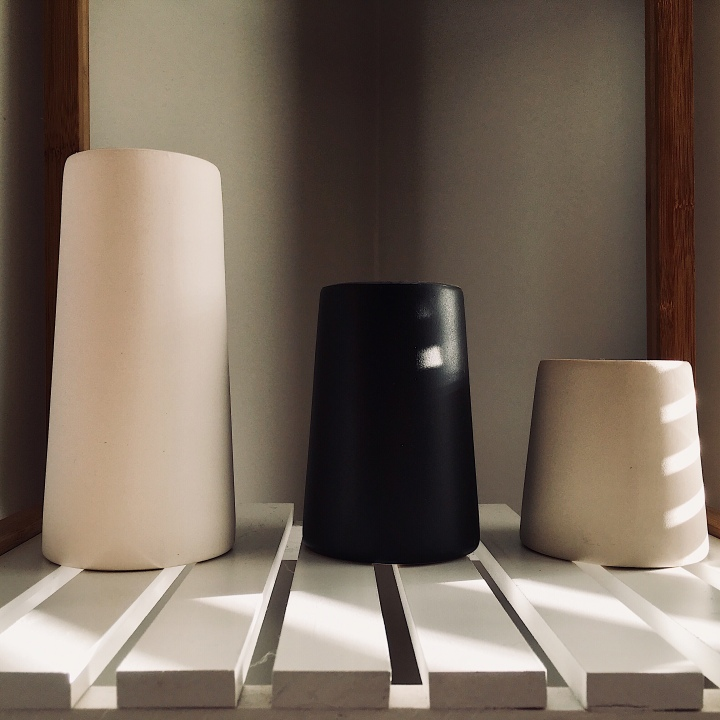 Set of three Country Road vases in white, black and taupe.