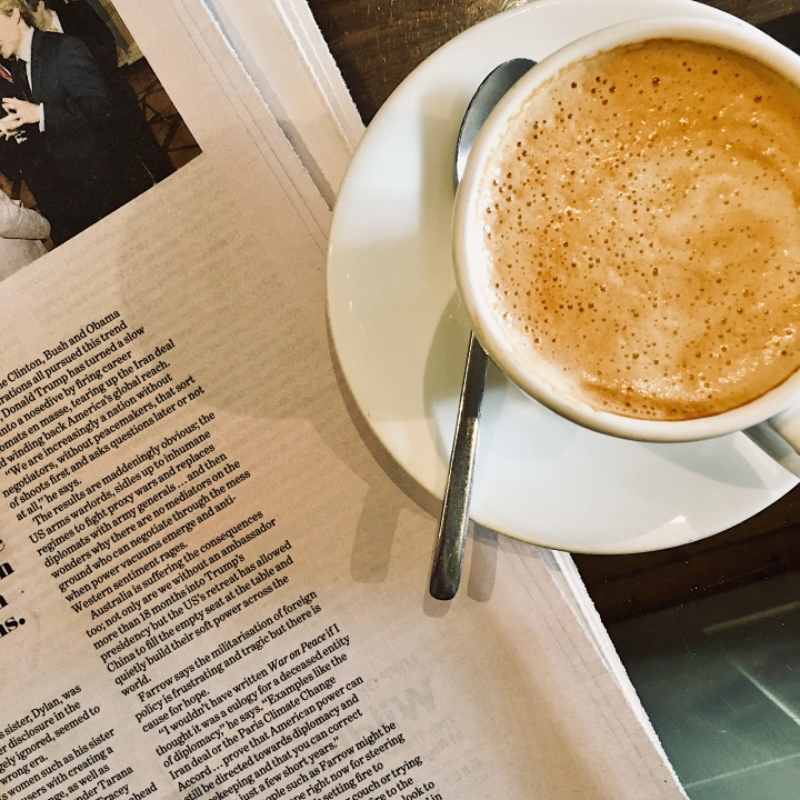 Cup of coffee and newspaper.