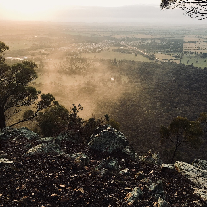 Early morning mist swirls around The Rock, New South Wales, Australia.