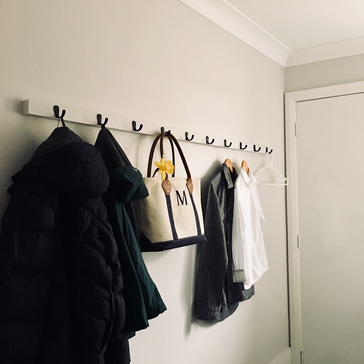 Coat rack in laundry.