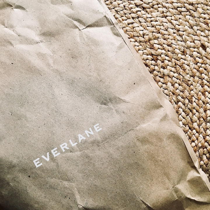 Everlane package on jute rug.