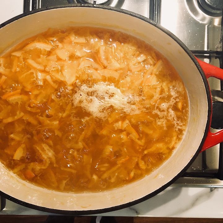 Marmalade bubbling on a gas hob.
