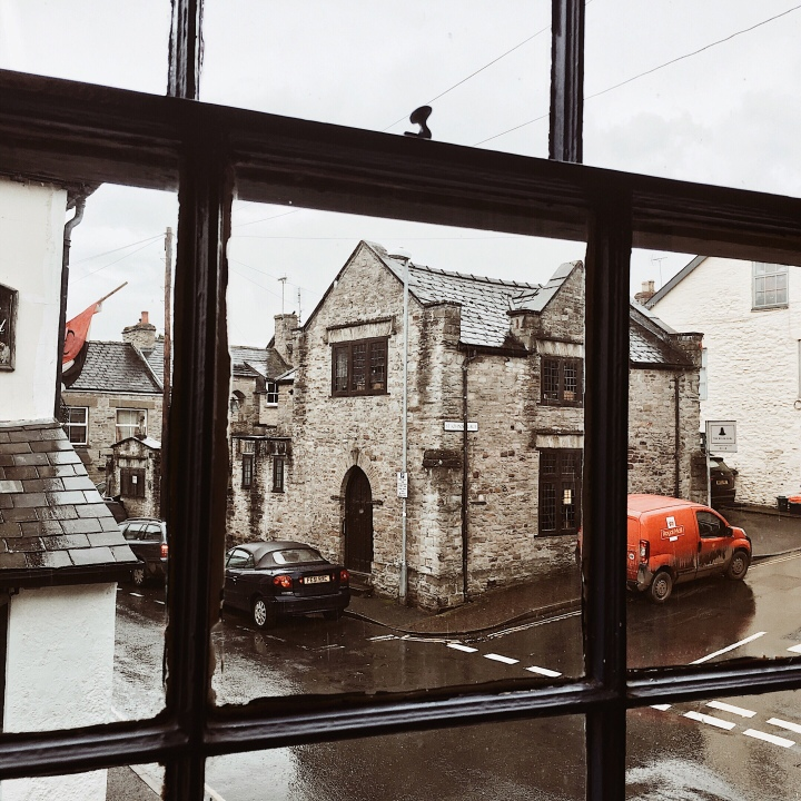 Looking out of a window onto a rainy Hay-on-Wye, Herefordshire, England.