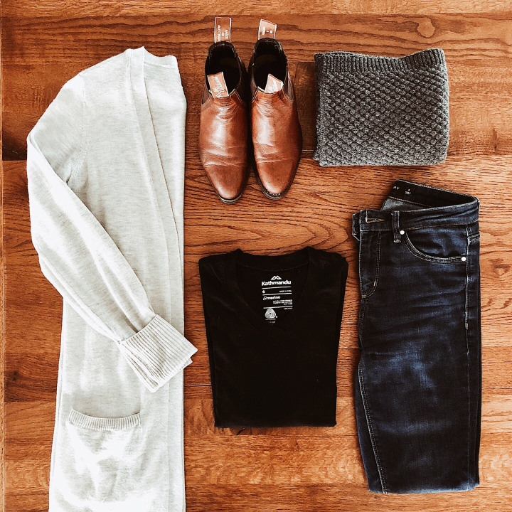 Flat lay of cream cardigan, black merino t-shirt, dark denim jeans, RM Williams boots and grey scarf.