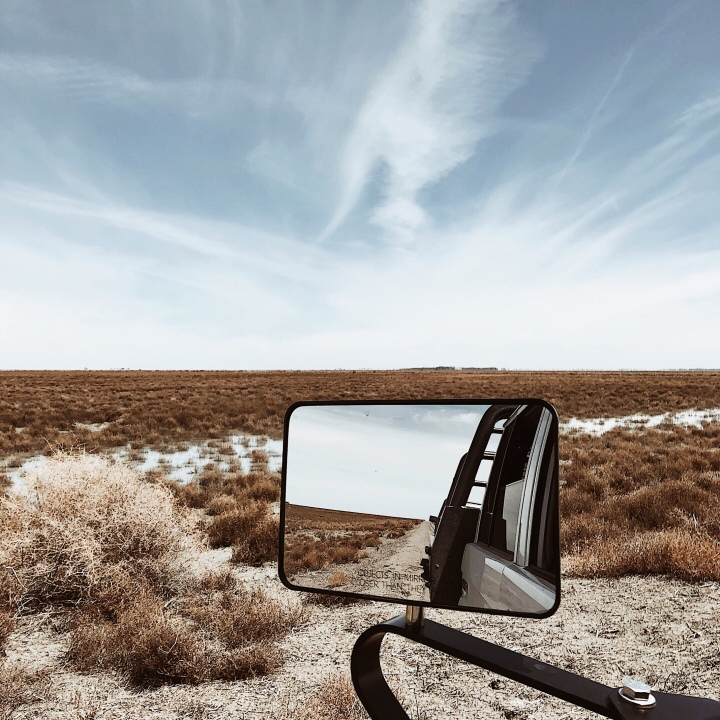 Looking out a rear-view mirror onto the Nimmie-Caira wetlands in western New South Wales, Australia.