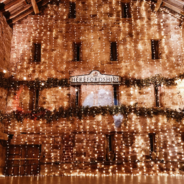 Fairy lights in the barn at Lyde Court, Herefordshire, England.