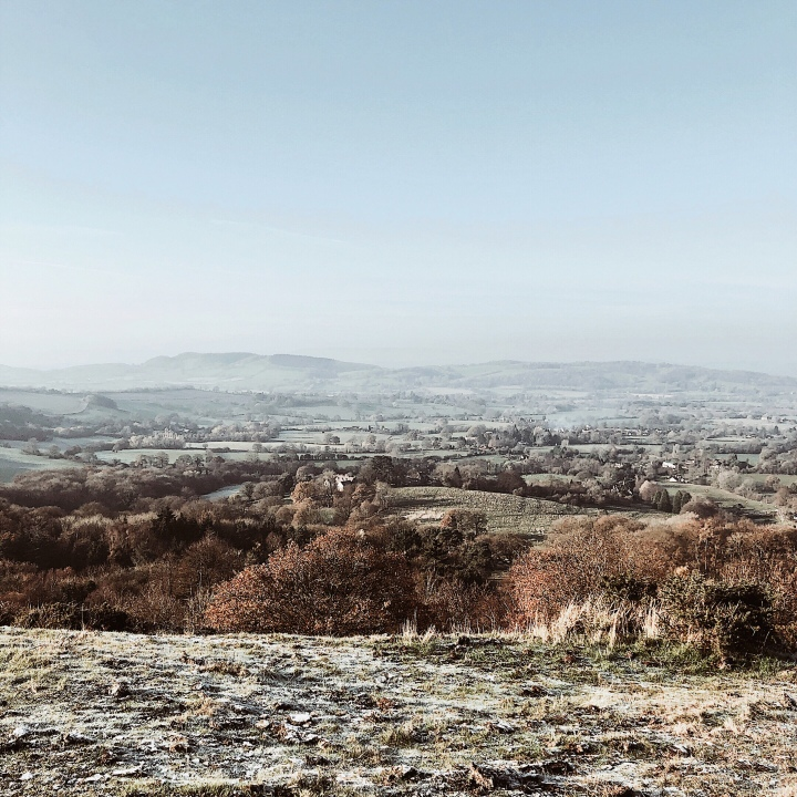 Looking out towards Herefordshire atop a frosty Malvern Hills in Worcestershire, England.