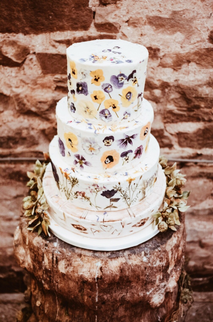 Flower covered, three tiered wedding cake.
