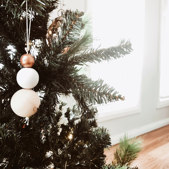 Simple bauble hanging on Christmas tree.
