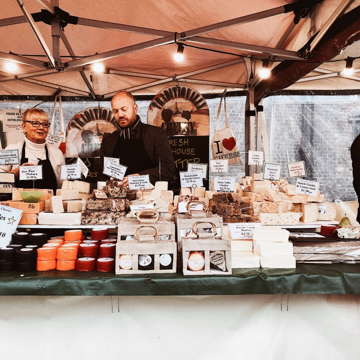 Stall selling cheese at the Worcester Christmas Fayre, England.