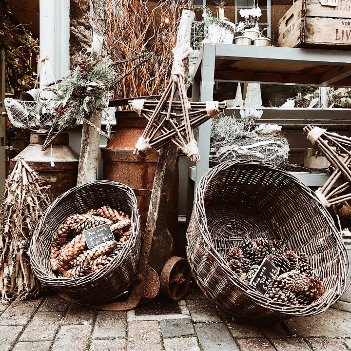 Pinecones in baskets outside of a florist in Worcester, England.