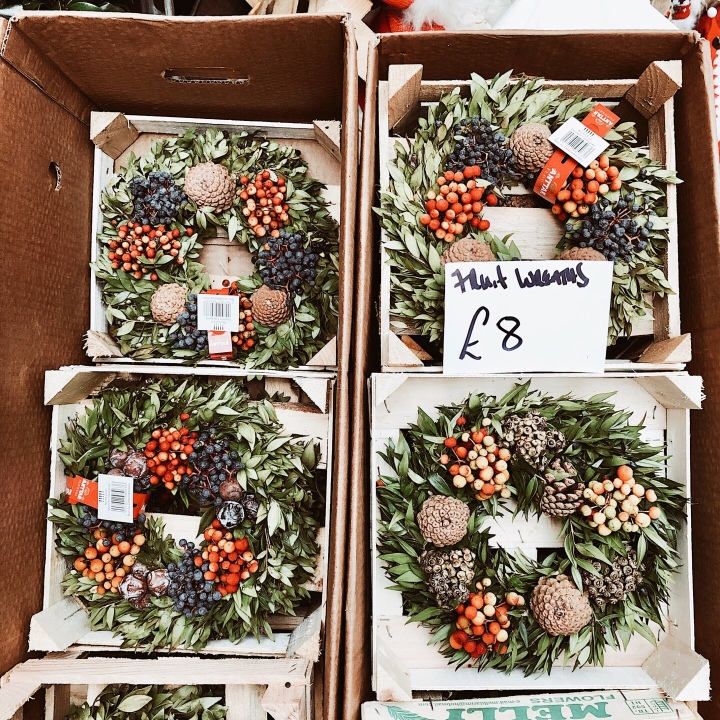 Christmas wreaths for sale at the Worcester Christmas Fayre, England.