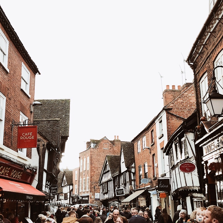 Shops and crowds at the Worcester Christmas Fayre, England.