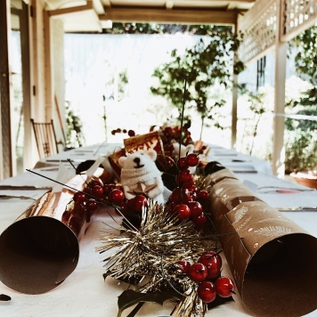 Table under verandah decorated for Christmas.