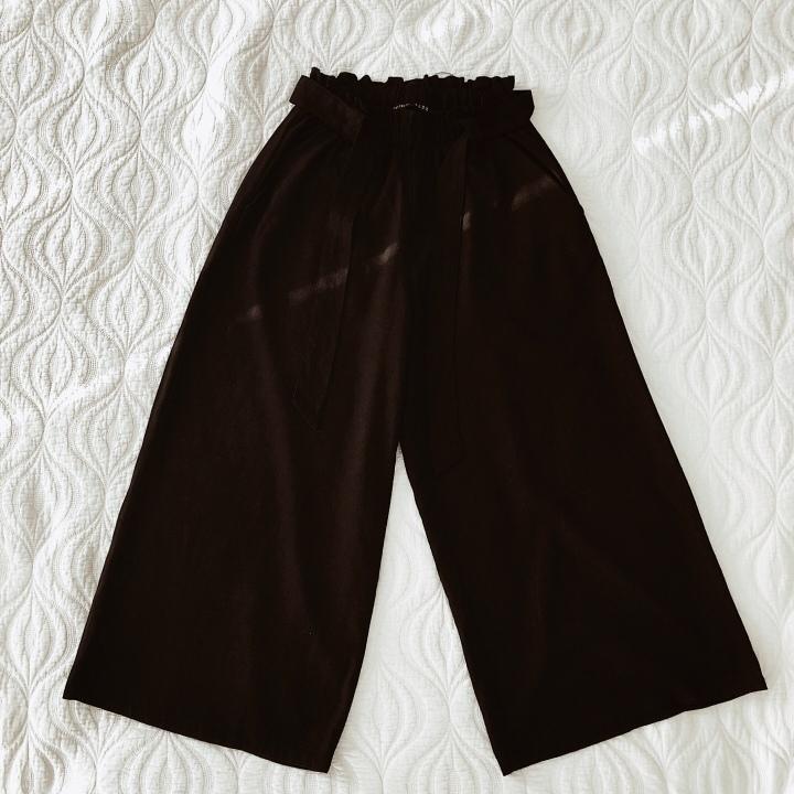 Black wide leg linen blend trousers.