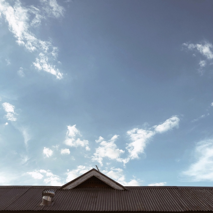 Tin roof and blue sky in Wagga Wagga, New South Wales, Australia.