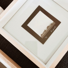 Framed black and white photograph.