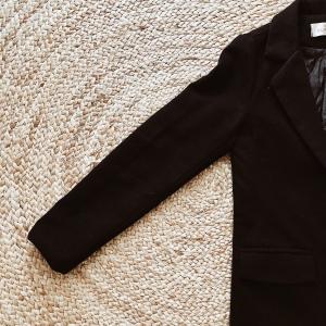 Vintage black knee length jacket.