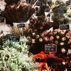 A flower seller at the Queen Victoria Market in Melbourne, Victoria, Australia.