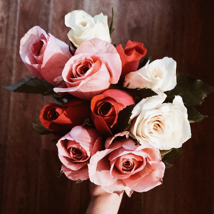 A bunch of pink, white and red roses.