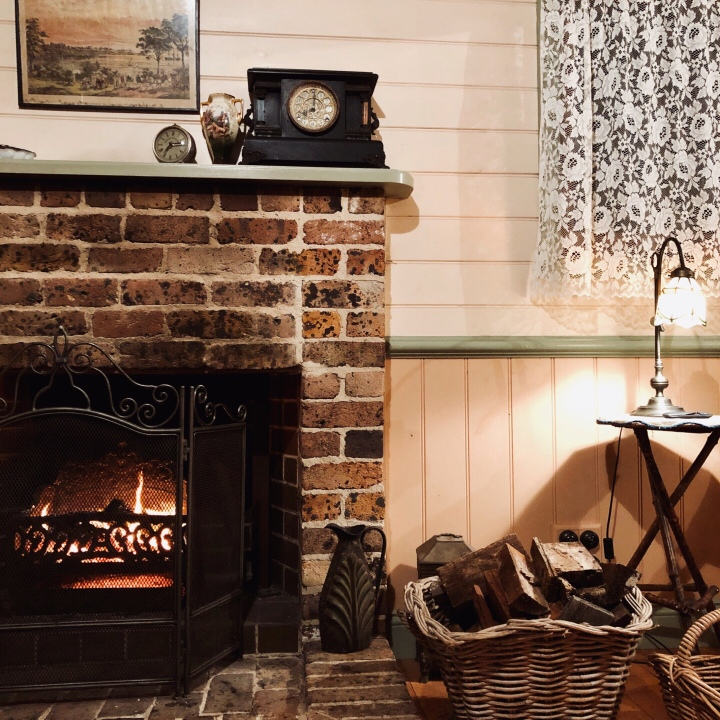 Fireplace in Settlers Cottage, Kangaroo Valley, New South Wales, Australia.